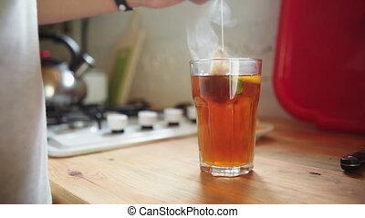 Man in the kitchen preparing tea