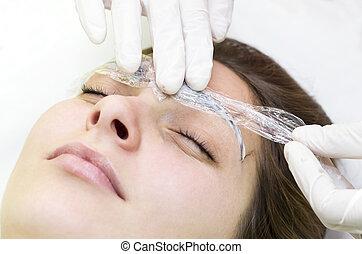 Man in the mask cosmetic procedure in spa salon