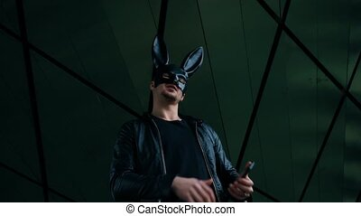 Man in the mask of a hare is dancing