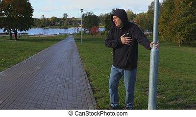 Man in the park lacks breath