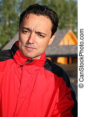 man in the red jacket