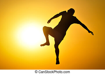 Man in the sunset jump