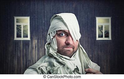 Man in toilet paper in neglected room