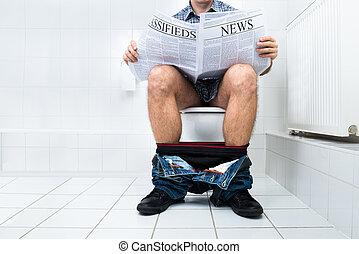 Man In Toilet Reading Newspaper