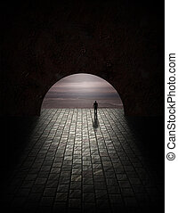 Man in tunnel with gloomy ocean view