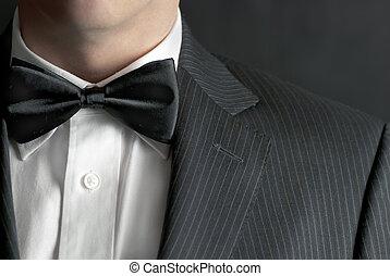 A close-up shot of a man wearing a tux.