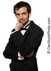 Man in tuxedo - Attractive young brunette man with a beard...