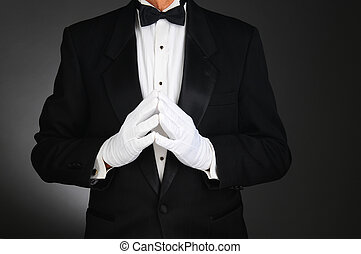Man in Tuxedo with Hands in Front - Closeup of a man wearing...