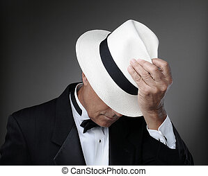 Man in Tuxedo with Panama Hat - Closeup of a middle aged man...