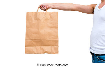 Man in undershirt holding a paper bag isolated on white...
