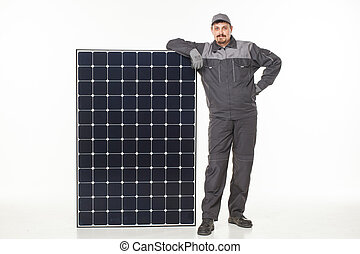 man in uniform with a solar battery