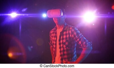 Man in virtual reality glasses looks at space that surrounds