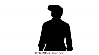 Front view of a man looking around and wearing a VR headset, black silhouette on a white background