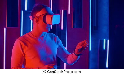 Man in VR headset touching virtual object.