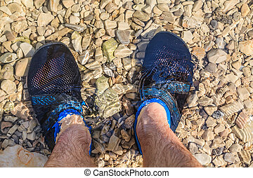 Man in water shoes