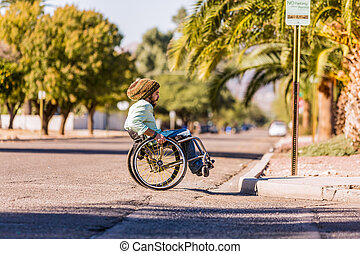 Man in Wheelchair Approaching City Curb