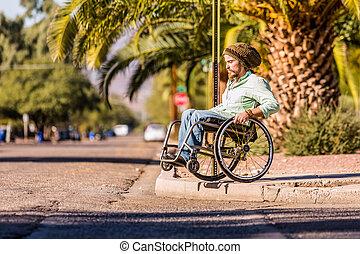Man in Wheelchair Approaching High City Curb