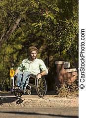 Man in Wheelchair at City Curb