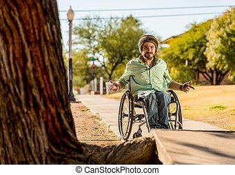Man in Wheelchair Gestures at Sidewalk Obstacle