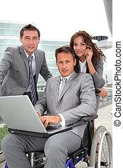 Man in wheelchair in business travel