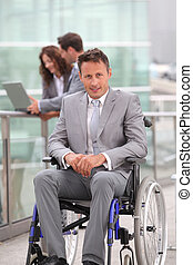 Man in wheelchair in business travel