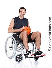 Man in wheelchair playing basketball