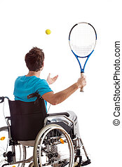 Man in wheelchair playing tennis, isolated white background