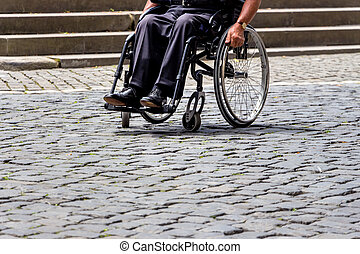 man in wheelchair - switzerland, zurich, man in a wheelchair...