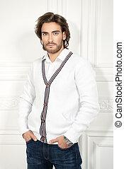 man in white cardigan