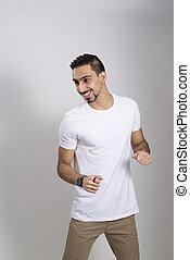 Man in White Shirt and Khaki Pants in a Playful Mood