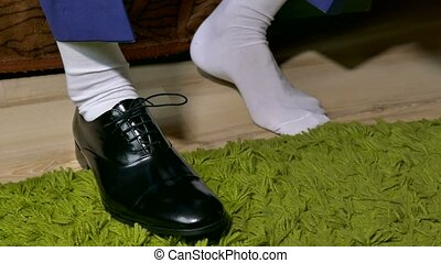 man in white socks dress to tie shoelaces shoes - man in...