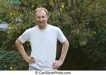Man in White T Shirt - Man in a white Tshirt standing in a...