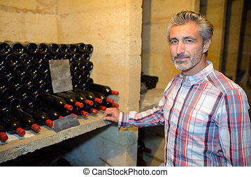 Man in wine cellar