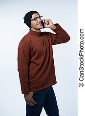 Man in winter cloth talking on mobile phone