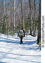 Man in winter forest 11