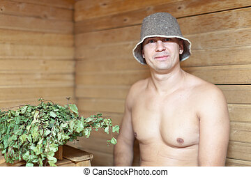Man in wooden sauna