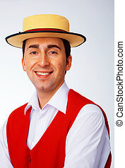 Man in yellow hat and red waistcoat