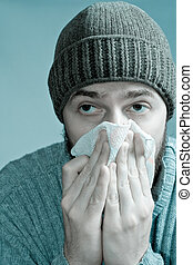 Man infected with flu virus - Portrait of sore man infected...