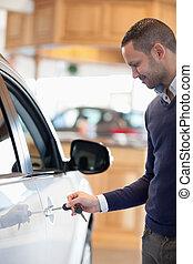 Man inserting a car key