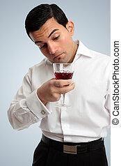 Man inspecting wine