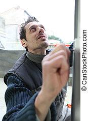 Man installing new window