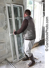 Man installing new windows