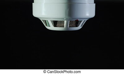 Man installs a sensor fire protection system. 4K video