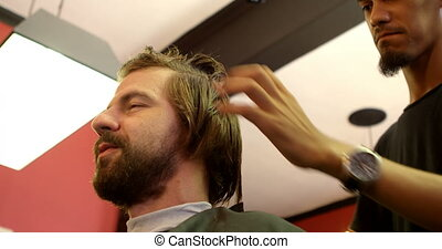 Man interacting with barber while trimming his hair 4k - Man...
