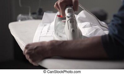 Man iron shirt - Man iron white shirt indoors