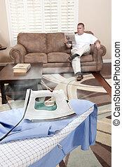 Man ironing shirt