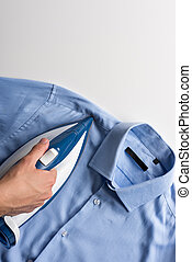 man ironing shirt