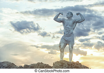 Man is a living statue. - Man living statue against the...