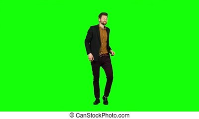 Man is dancing energetically, he is having fun. Green screen