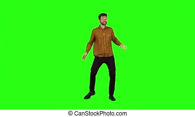 Man is dancing energetically, he is having fun. Green screen. Slow motion